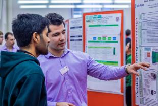 Chemical Engineering Students viewing posters at the Jubilee 5th year poster event